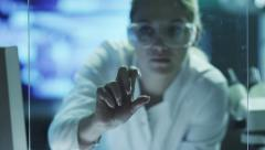 Woman Scientist is Using Futuristic Interface on Glass. Mock-up Stock Footage