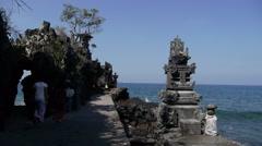 2 girls walk to beach temple,Senggigi,Lombok,Indonesia Stock Footage