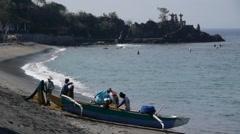 Fischerman on beach,Senggigi,Lombok,Indonesia Stock Footage