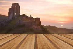 Beautiful dreamy fairytale castle ruins against romantic colorful sunrise wit Kuvituskuvat