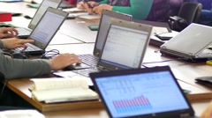 Participants using laptops during educational business conference - stock footage