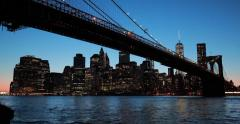 New York City Brooklyn Bridge skyline sunset evening night Stock Footage