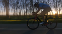 Cyclist man racing bike outdoor tracking shot 4k Stock Footage