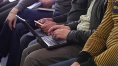 Participants with tablets and laptops listen to educational business training - stock footage