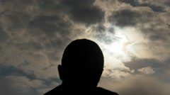 Man head silhouette with fast moving clouds time lapse Stock Footage