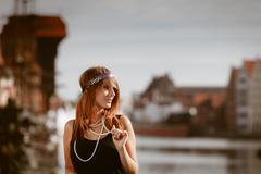 Flapper girl woman in1920s style standing on the street Stock Photos