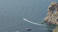 Boat speeding around Spanish Coastline Stock Footage