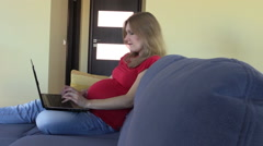 Serious pregnant business woman work with notebook at home Stock Footage