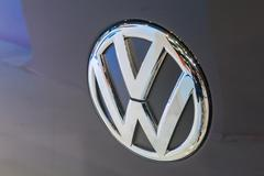 Close up logo of Volkswagen - stock photo