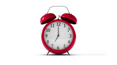 Classic red alarm clock going off on isolated background - stock footage