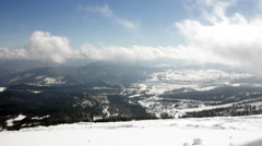 Picturesque view of snowy mountains in sunny day with clowds Stock Footage