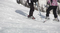 Instructor teaches the skier to ride on a mountain top Stock Footage