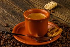 Cup of coffee, sweet and coffee beans Stock Photos
