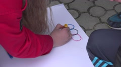 Children's hands painted markers color poster Stock Footage