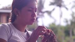 Young lady eating hamburger Stock Footage