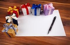 Blank card with gift boxes - stock photo