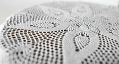Stock Photo of flower on lace doily