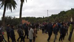 People walking in Park Guell in Barcelona, Spain. Stock Footage