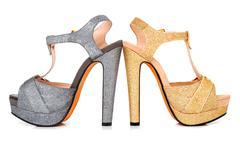 Golden and grey luminous woman shoes Stock Photos