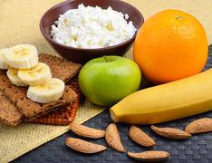 Healthy eating. Fresh fruit, cheese and almonds - stock photo