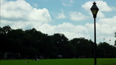 Sunbathing in Forsyth Park, Savannah, GA Timelapse - stock footage