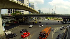 BANGKOK - March 2015: Bangkok's traffic with BTS sky trains passing by. Stock Footage