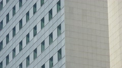 Tall office building exterior, panning Stock Footage