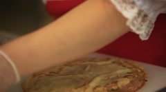 Chef women hands cooking boiled eggs with onion filled pancakes. Close up. HD Stock Footage