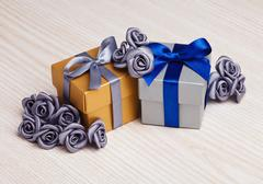 Grey flowers and two gift boxes Stock Photos