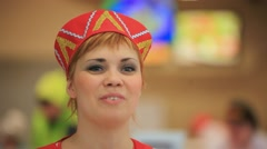 RUSSIA, MOSCOW, 7 MARCH 2015,  Smile young woman in russian traditional costume Stock Footage