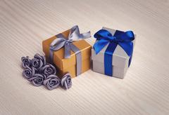 grey flowers and two gift boxes - stock photo