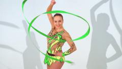 Beautiful acrobat dancing with a sash in slow motion Stock Footage