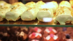 Showcase of cakes,  pastry in window display canteen for tasty desert food. HD Stock Footage