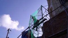 Construction workers on scaffolding Stock Footage