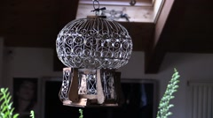 Vintage empty Old bird cage swinging in a living room Stock Footage