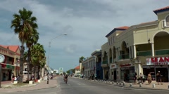 Stock Video Footage of Aruba Oranjestad 002 coast road with palm trees and Dutch houses