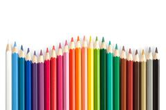 Color pencils in arrange in color wheel colors on white background Stock Photos