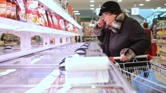 RUSSIA, MOSCOW, 7 MARCH 2015, Fat woman buying dairy or refrigerated groceries - stock footage