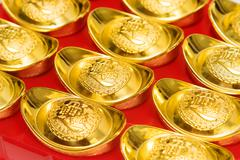 Stack of gold ingots and Blessing word. - stock photo