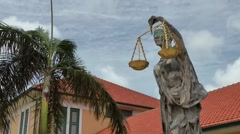 Aruba Oranjestad 030 Justice statue in front of local court house Stock Footage
