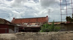 Stock Video Footage of Aruba Oranjestad 037 stone wall and damaged house in poor settlement outskirts