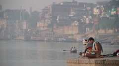 Hindu man doing excercise at the Ganges,Varanasi,India Stock Footage