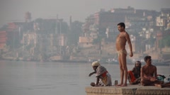 Hindu man doing breath excercise at the Ganges,Varanasi,India Stock Footage