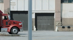 ESTABLISHING SHOT OF A LOADING DOCK WITH SEMI TRUCK. Stock Footage