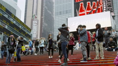 teenage tourists posing for pictures red stairs busy crowded Times Square NYC 4K - stock footage