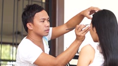 Make-up artist doing eye brows - stock footage