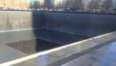 Pan and tilt at 9/11 memorial to Freedom Tower Stock Footage