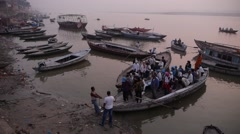 A boat with pelgrim tourists unboard,Varanasi,India Stock Footage