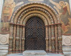 Main gate entrance into the Cathedral of the Assumption in the Kremlin. Highl Stock Photos
