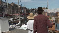 Honfleur - Artist  at work painting harbor scene Stock Footage